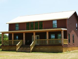 Milam lodge photo - Rear features HUGE covered deck that faces Toledo Bend Reservoir.
