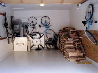 Sunriver house photo - Garage with Bikes and Firewood Storage