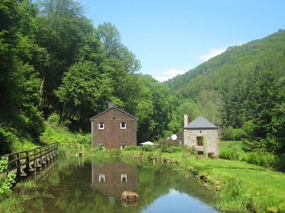 Beautiful cottage in a wooden chalet next to a water mill.