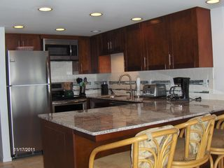 Honokowai townhome photo - Full kitchen with all the necessities makes it easy to save money dining in.