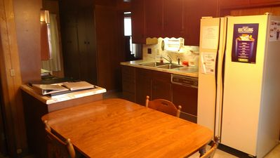 Lake Placid house rental - Galley kitchen: Dining room to the right rear.