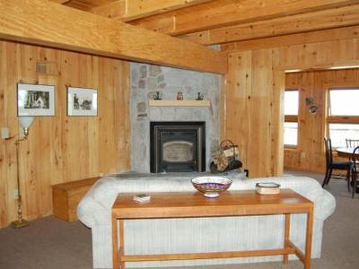 Ely house rental - Corner Fireplace 'Beautiful rough hewn pine from the surrounding forests.'
