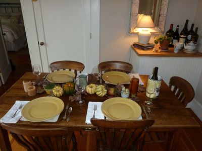 Dine inside on this antique walnut table. Door behind goes down to wine cellar.