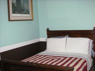 Pensacola house photo - Guest room has an elegant bed and handsewn quilt