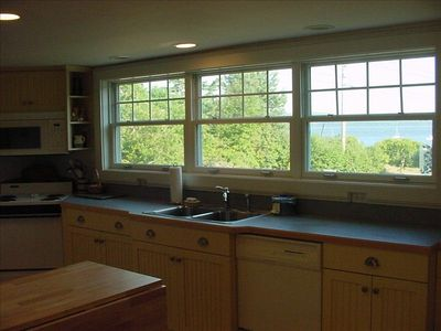 View across to the water from large well appointed kitchen that is fun to use!