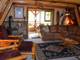 Lake Roosevelt house photo - Native Americana livingroom with view of sleeping porch