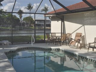 Cape Coral house photo - Swimming Pool with canal in background