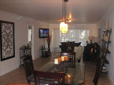 Dining and Living room area with 40'' flat screen, DVD player.