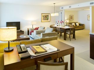 Honolulu condo photo - TrumpWaikiki 2503 is spacious and stunning. Living and dining area and den.