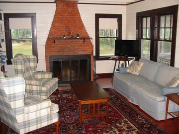Living area with working fireplace and HDTV