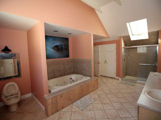 Tannersville house photo - Master Bathroom with Soaking Tub, Double Vanities, and Full Stand Up Shower