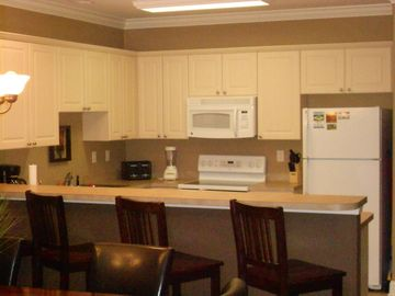 Large fully equipped kitchen with very long breakfast bar.