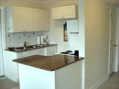 Granite Countertops with Breakfast Bar & Seating for Four