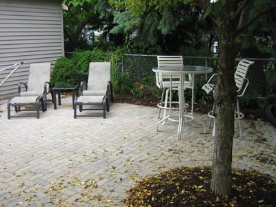 Private backyard with a brick pavered patio