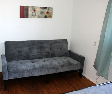 Additional fold-down couch in master bedroom
