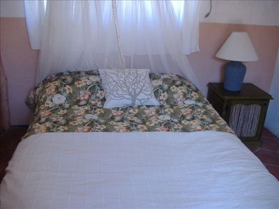 "Queen bed in ""guest room"". This room has private bathroom attached."