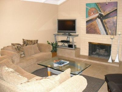 Living Room with two sofas, recliner,gas fireplace, LCD TV