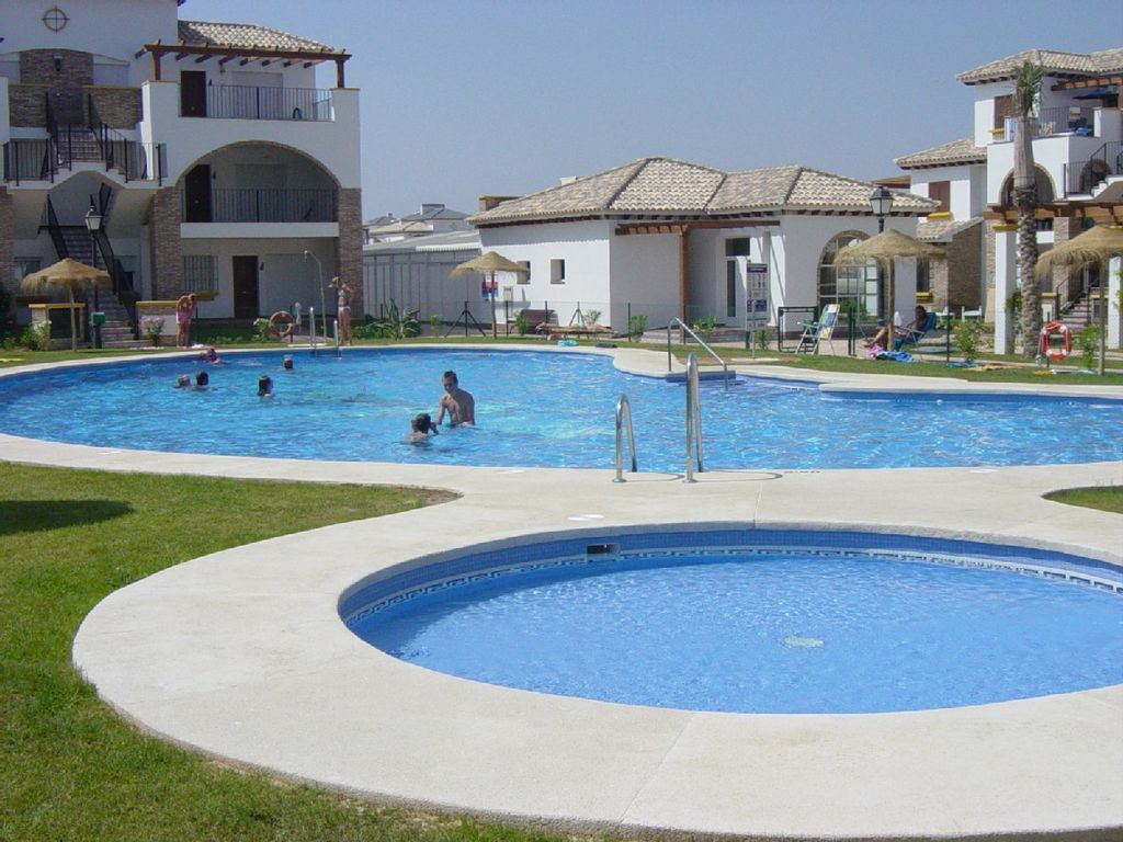 Beautiful ground floor apartment with large outdoor for Heated garden swimming pools