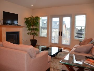 Lots of seating in the living room; gas fireplace; flat screen tv; gas bbq