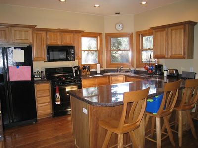 Great working kitchen open to the large family room