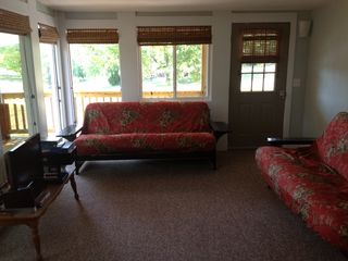 Sunroom entry from side deck, use when 1st arriving. Light switch left of door.