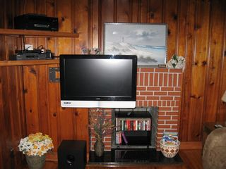 Private Homes cottage photo - Living room with flat screen tv mounted on swivel bracket and surround sound
