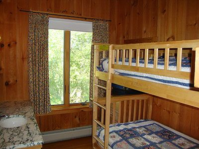 Bunk Room with Twin Size Beds and a Sink in the Room.