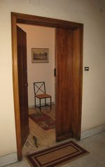 Trastevere area condo photo - Our front door opens to offer a place to take off your shoes after walking Rome