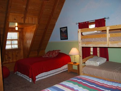 Upstairs bedroom- 2 full beds and bunkbed, cozy & cute for a good night's sleep!