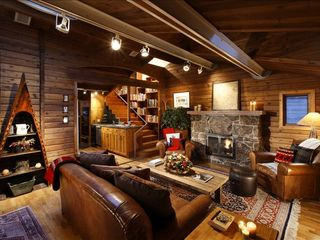 Aspen house photo - Rustic stone fireplace and hickory walls