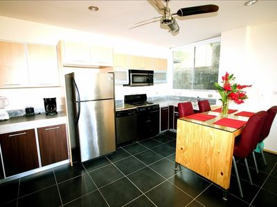 Modern Kitchen: Refridgerator, full size oven, top mounted Microwave, disposal