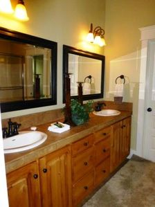 Master Travertine Tile Bathroom with Soaker Tub, Walk-in Closet and Dual Vanity