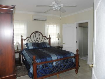 Large Bedroom with attached bath and Queen Bed
