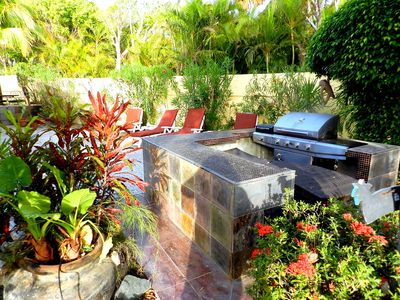 Our lush backyard includes and outdoor kitchen with gas grill