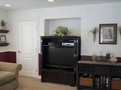 Family room has a large flat screen TV, PS3, satellite channels & DVD collection
