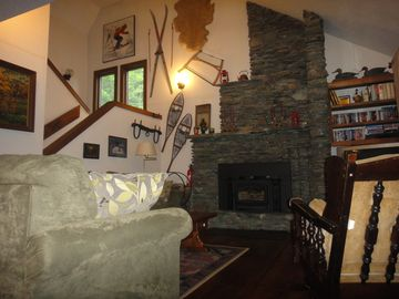 Living room/ fieldstone fireplace