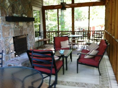 Porch for entertaining or relaxing. Seats at least 12 more for dining.