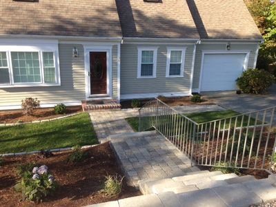 New stone steps and  railing for step down assistance. New driveway since photo.
