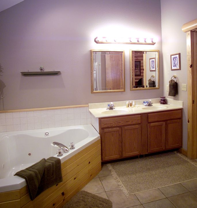 Master bathrooms have double vanities and double whirlpool tubs.
