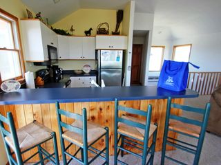 Corolla house photo - Bar seating in the kitchen