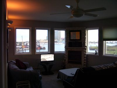 LARGE LIVING ROOM WITH SPECATULAR DAY AND EVENING VIEWS OF THE CASINOS AND MARINA