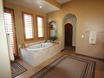 Over-sized jacuzzi tub in master bath.