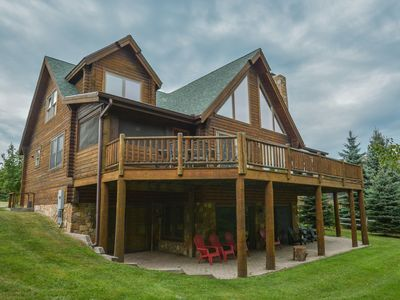 Level lake front & fire pit on 1+Acres!