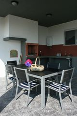 Terceira Island house photo - Lower level patio view with bbq grill and wood burning oven