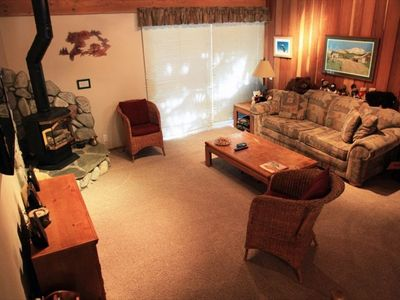 Mammoth Lakes condo rental - Spacious living area surrounds custom stone fireplace - new carpet in 2011!