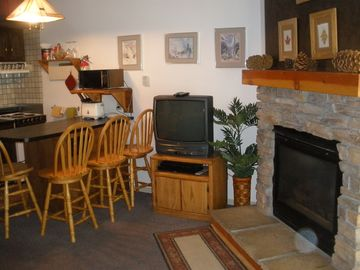 Yosemite National Park condo rental - Gas fireplace and eating area