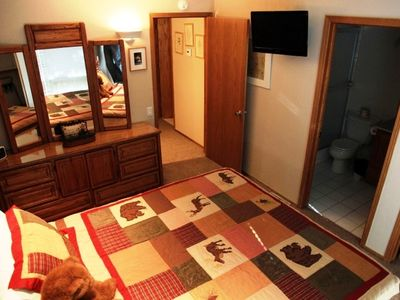 Master bedroom with attached bath and flat screen TV | Mammoth condo rental