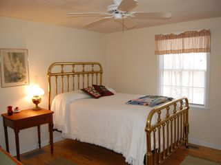 Brewster house photo - Bedroom with antique brass double bed