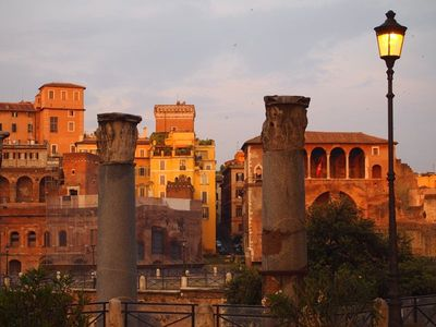 ( Betwen columns ) the Palazzo del Grillo overlooking the Imperial Forums