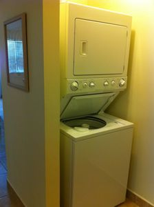 Washer/dryer combo just off the kitchen.